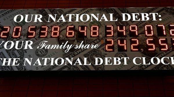 14-значная сумма: вНью-Йорке табло показывает госдолг США
